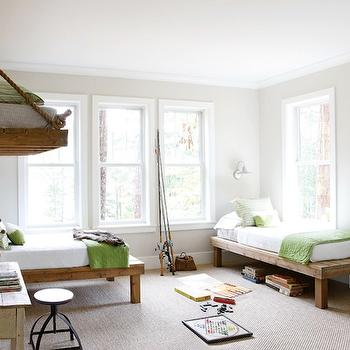 Fun, playful boy's bedroom with rustic twin bed, wood platform beds, rustic desk, ...