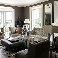 1st Option - living rooms - gray, tufted, velvet, sofa, charcoal, gray, linen, tufted, wingback, slipper, chairs, black, leather, tufted, rectangular, ottoman, vintage, trunk, cowhide, rug, polished nickel, ginger jar, white, gray, striped, high-back, chairs, white, lamps, gray, taupe, grasscloth, wallpaper, bay windows,