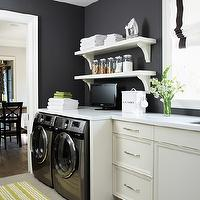 House & Home - laundry/mud rooms - navy blue, walls, white, yellow, striped, runner, washer, dryer, white, cabinets, white, shelves, white, corbels, white, quartz, countertops, white, roman shade, navy blue, ribbon trim, laundry shelves, laundry room shelves, laundry room shelving, laundry room shelf,