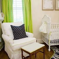 A La Mode Maven - nurseries - ivory, walls, green, silk, drapes, white, glider, green, piping, navy, blue, polka dot, pillows, Jonathan Adler, navy blue, zebra, cowhide rug, green trim, white, vintage, crib, gold leaf, framed, baby clothes, vintage stool,