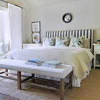 Kerrisdale Design - bedrooms - tan, walls, built-in, window seat, white, drapes, white, bench, nailhead trim, jute, rug, white, nightstands, black, convex, mirror, Pottery Barn Pick-Stitch Quilt, Pottery Barn Wood Gallery Frame, Dwell Studio Oversize Stripe - Charcoal, Robert Abbey Alvin Polished Nickel Boom Desk Lamp, PB Grand Phone,