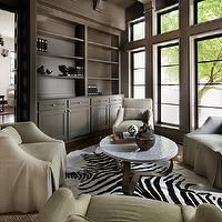 Simple Everyday Glamour - dens/libraries/offices - taupe paint, taupe built-in cabinets, taupe cabinets, taupe paint, taupe paint colors, taupe paint color, taupe walls, zebra rug, zebra cowhide rug, pico cocktail table, slipcovered chairs,