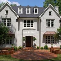 home exteriors - metal roof, painted brick,  Stunning home with painted brick and metal roof accents