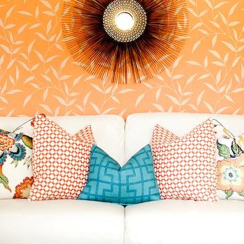 Caitlin Wilson Design - living rooms - peacock blue pillow, bleeker pillow, chiang mai dragon pillow, orange wallpaper,  Colorful living room