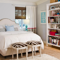 Turquoise LA - bedrooms: zebra ottoman, french zebra ottomans, zebra stools, french zebra stools, nailhead headboard, ivory headboard, ivory headboard with nailhead trim, west elm nightstands, white lacquer nightstands, zigzag pillows, turquoise lamps, turquoise blue lamps, trellis curtains, trellis drapes, layered rugs, bookcase, white bookcase, trellis wallpaper, wallpapered back bookcase, wallpaper on back of bookcase, wallpaper on back of bookshelf,