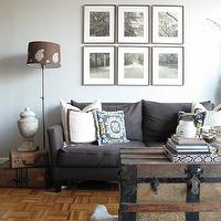 design 59 - living rooms - parquet wood floor, parquet floor, open floor plan, charcoal gray sofa, trunk as coffee table, trunk coffee table, art over sofa, art above sofa,