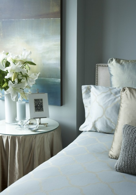 HGTV - bedrooms - Benjamin Moore - Tranquility - Heather Ross' The Space Between Stretched Canvas Print, blue walls, blue paint, blue paint color, blue bedroom walls, blue bedroom paint, blue bedroom paint color, skirted table, round skirted table, skirted round table, skirted nightstand, skirted bedside table, nailhead headboard, blue bedding,