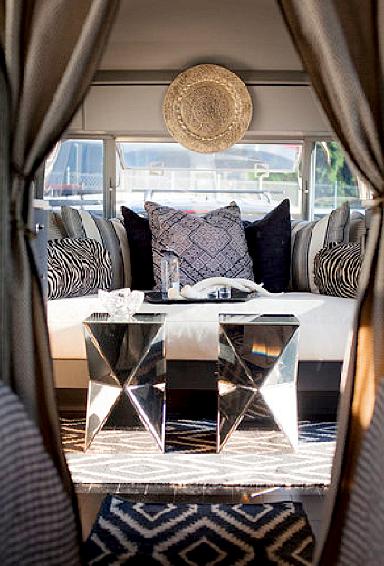 living rooms - West Elm Faceted Mirror Side Table taupe gray silk drapes daybed gray blue pillows navy blue diamonds rug  Chic trailer design