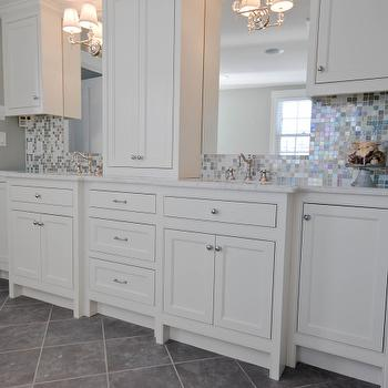 HGTV - bathrooms - iridescent glass tiles, iridescent backsplash, iridescent bathroom backsplash, iridescent glass backsplash, iridescent glass bathroom backsplash, iridescent tiled walls, iridescent tile backsplash, white bathroom cabinets, white marble countertops, grays late floor, gray slate bathroom floor, slate floor, slate bathroom floor,