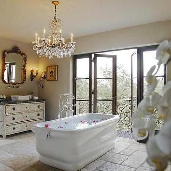 bathrooms: bathroom balcony, master bathroom balcony, folding doors, balcony folding doors, soaking tub, spa like bathroom, spa bathroom, french vanity, french bathroom vanity, crystal chandelier, bathroom chandelier, chandelier over bathtub, french mirror,