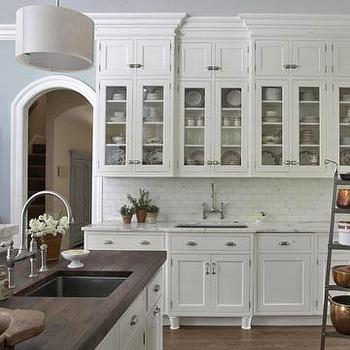 BHG - kitchens - walnut butcher block, scandinavia walnut, scandinavia walnut butcher block, scandinavia walnut countertop, walnut butcher block countertop, island sink, glass front kitchen cabinets, white kitchen cabinets, 2 tone countertops, white marble countertops,