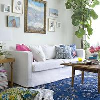 Emily Henderson - living rooms - blue, Greek key, rug, white, slipcovered, modern, sofa, pink, blue, pillows, mid-century, modern, coffee table, eclectic, art gallery, gray, walls, Fiddle Leaf Fig Plant,