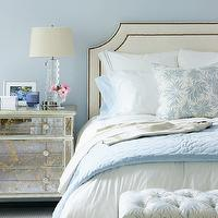 Muse Interiors - bedrooms - ivory, blue, tufted, bench, ivory, headboard, French, brass, tacls, antique, mirrored, nightstand, stacked, glass, lamp, blue, walls, mirror nightstands, mirrored nightstands, mirrored bedside tables,