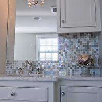 HGTV - bathrooms - iridescent glass tiles, iridescent backsplash, iridescent bathroom backsplash, iridescent glass backsplash, iridescent glass bathroom backsplash, iridescent tiled walls, iridescent tile backsplash, white bathroom cabinets, white marble countertops,
