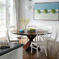 Muse Interiors - dining rooms - chair rail, beadboard, crossed legs, round, wood, dining table, white, dining chairs, blue, walls, French doors, clear, glass, pendan, blue, brown, drapes,