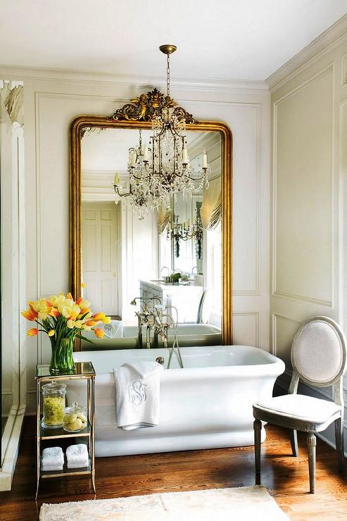 Amy D. Morris Interiors - bathrooms - Waterworks Easton Etagere, gilt floor mirror, bathroom floor mirror, floor mirror in bathroom, soaking tub, etagere, bathroom etagere, bathroom chair, french bathroom chair,