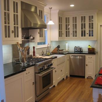 HGTV - kitchens - absolute black granite, absolute black granite countertops, glass front kitchen cabinets, white cabinets with absolute black granite, white kitchen cabinets with absolute black granite countertops, farmhouse sink,