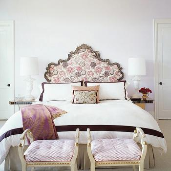 Jeffers Design Group - bedrooms - lilac and purple bedroom, lilac walls, lilac bedroom walls, french headboard, patterned headboard, mirror nightstands, mirrored nightstands, border bedding, pink ottomans, pink stools, urn lamps,