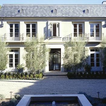 Studio William Hefner - home exteriors - french chateau, french home exterior,  Lovely modern French home exterior with white stucco, gray shingles