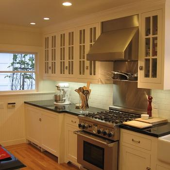 HGTV - kitchens - absolute black granite, absolute black granite countertops, glass front kitchen cabinets, white cabinets with absolute black granite, white kitchen cabinets with absolute black granite countertops,