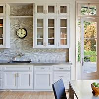 Studio William Hefner - kitchens - beveled countertops, glass front kitchen cabinets, ivory cabinets, ivory kitchen cabinets, silver countertops, silver kitchen countertops, kitchen bookcase,