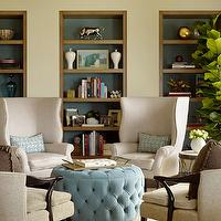 Jeffers Design Group - dens/libraries/offices - blue, round, tufted, ottoman, light gray, wingback, chairs, mushroom, linen, vintage, chairs, built-ins, blue ottoman, tufted ottoman, velvet ottoman, blue tufted ottoman, blue velvet ottoman, blue velvet tufted ottoman, tufted velvet ottoman, velvet tufted ottoman, round ottoman, round velvet ottoman, round tufted ottoman, round blue ottoman,
