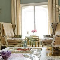 living rooms - blue, green, walls, French, linen, wingback, chairs, bird cage, white, tufted, rectangular, ottoman, French, linen, settees, nesting, tables, ivory, linen, drapes, capiz, tray,