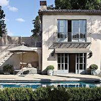 Studio William Hefner - decks/patios - french patio, french home exterior,  Lovely modern French home exterior with white stucco, gray shingles,