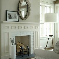 Wettling Architects - living rooms - mirror above fireplace, mirrors above fireplace, mirror over fireplace, mirrors over fireplace, fireplace mirror, fireplace mirrors, oval mirror, oval fireplace mirror, white brick fireplace, tripod floor lamp,