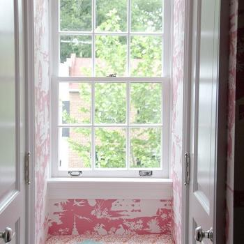 Zoe Feldman Design - girl's rooms - reading nook, window seat, built in window seat, kids window seat, kids built in window seat, pink toile wallpaper, pink toile, bi fold doors, secret reading nook, secret window seat,