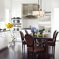 Traditional Home - kitchens - chocolate, brown, velvet, oval back, chairs, nailhead trim, chocolate, stained, dining table, honed, black, granite, countertops, bar cart, white, shaker, kitchen cabinets, white, subway tiles, backsplash,