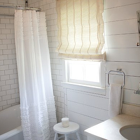 Milk and Honey Home - bathrooms - subway tiles, shower surround, vintage, clawfoot tub, wall panels, rectangular, pivot, mirror, white, vintage, stool, rice paper, roman shade, Viva Terra Lotus Flower Small Chandelier, Target Ruffles Shower Curtain,