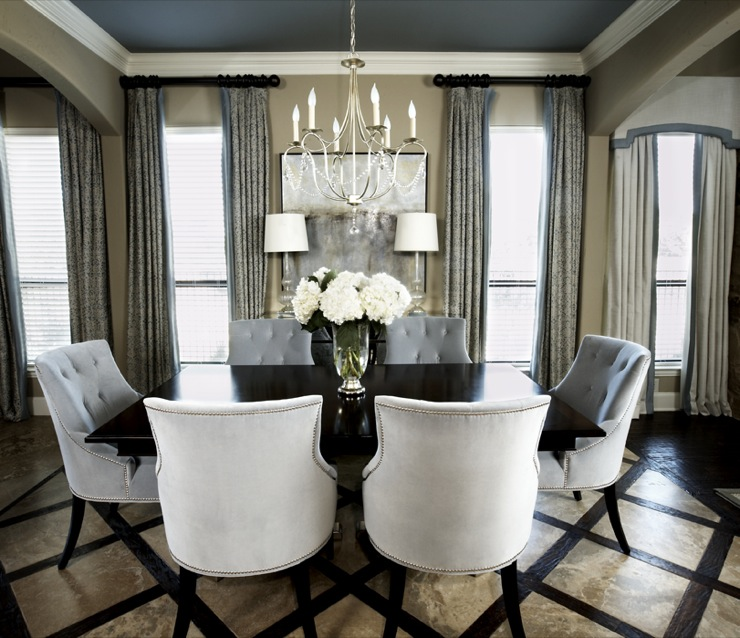 EJ Interiors - dining rooms - Currey and Company crystal chandelier and glass lamps, gray blue painted ceiling, tufted dining chairs, inlaid travertine flooring, Kravet printed drapes, Ballard Designs artwork,