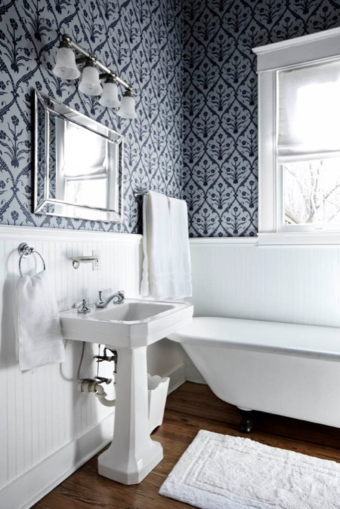 EJ Interiors - bathrooms - Wooden floors, white bathroom, wallpaper, beveled mirror, roman shade, white fabric, white rug, white towels, wainscoting, Lee Jofa wallpaper, polished nickel hardware, blue walls, beadboard walls,
