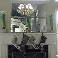 living rooms - Modern Christmas mantel, paperwhites, charcoal grey and cream stockings, Arteriors Nikita Iron Mirror,  Christmas decor courtesy
