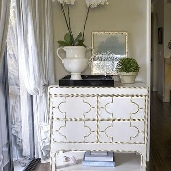 Erinn V Design Group - entrances/foyers - French brass tacks, nailhead trim, gold leaf, sliding glass doors. nailhead cabinet, studded cabinet, cabinet with nailhead trim, urn vase, frames seafan,