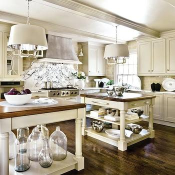 Design Galleria - kitchens - double islands, double center islands double kitchen islands, cream cabinets, cream kitchen cabinets, curved backsplash, curved kitchen backsplash, curved marble backsplash, six lights square tube chandelier, green glass tiles, green glass tiled backsplash,