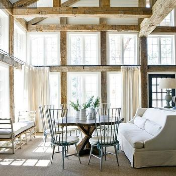 Atlanta Homes & Lifestyles - dining rooms - rustic ceiling, rustic wood ceiling, rustic, wood beams, reclaimed wood, crossed legs, round, dining table, sisal, rug, blue, high back, dining chairs, natural, linen, drapes, bench, cross leg table, cross legged table,