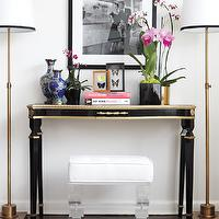 Style at Home - entrances/foyers - lucite bench, white lucite bench, lucite ottoman, black console table, foyer, black foyer table, black and gold console table, foyer, black and gold foyer table, antique brass floor lamps,