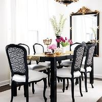 Style at Home - dining rooms - black and white dining room, black and white dining chairs, fretwork dining chairs, french dining chairs, black dining table, rectangular dining table, black rectangular dining table, black parsons dining table, parsons dining table, black and gold mirror, dining room mirror,