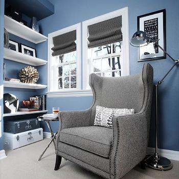 EJ Interiors - living rooms - Gray chair, roman shades, built in shelves, blue wall, task lamp, white and gray trunks, driftwood sculpture, floor lamp, twig table, gray chair, wingback chair, gray wingback chair,