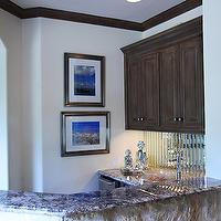 EJ Interiors - media rooms - Wet bar, framed wall art/photography, mirrored backsplash, granite counter tops, stone wall, taupe/brown painted cabinets, white walls, mirror backsplash, mirrored backsplash, bar mirror backsplash, bar mirrored backsplash,