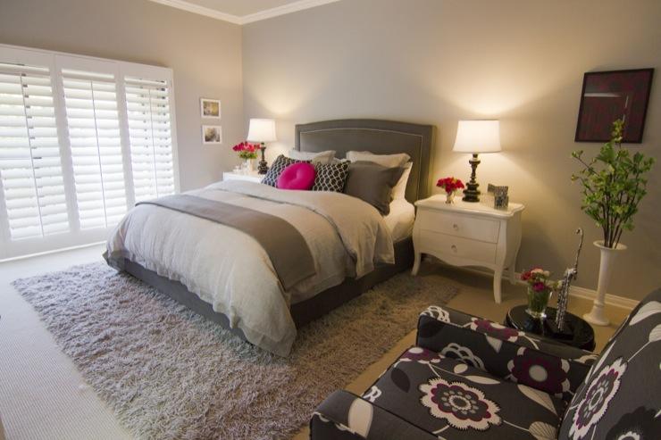 gray headboard with nailhead trim transitional bedroom