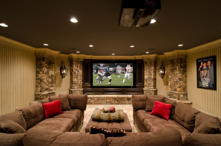 basements - movie room, basement movie room, U shaped sectional, brown sectional,  Basement media room/family room. Large dark brown sectional