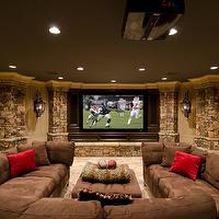 basements - basement, den, family, brown, stone,  Basement media room/family room. Large dark brown sectional sofa, large screen wall mounted