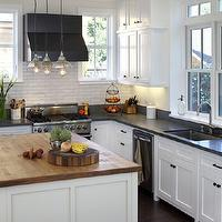 Artistic Designs for Living - kitchens - white, kitchen cabinets, honed, black, granite, countertops, kitchen island, butcher block, countertops, subway tiles, backsplash, vintage, mini-pendants, black, range, hood,