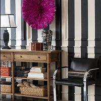 Chic, eclectic foyer entrance design with white & black striped painted vertical walls, ...