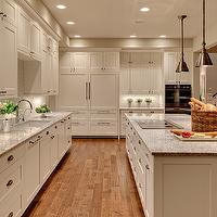 Studio 212 Interiors - kitchens - creamy, white, kitchen cabinets, cooktop, kitchen island, granite, countertops, paneled, fridge, dishwasher, appliances, tan, walls, rustic, hand scraped, wood floors, kashmir white, kashmir white granite, kashmir white granite counters, kashmir white granite countertops, kashmir white granite kitchen, kashmir white granite island, kashmir white granite island countertops, honed kashmir white granite, honed kashmir white granite counters, honed kashmir white granite countertops, honed kashmir white granite kitchen, honed kashmir white granite island, honed kashmir white granite island countertops, Benjamin Moore White Dove, Kashmir White Granite Countertop, Hudson Valley 9911 Darien 1 Light Mini Pendant, Vetro Neutra Listello Sfalsato Glass Mosaic- Bianco,