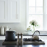 Linda McDougald Design - kitchens - white, shaker, kitchen cabinets, light gray, small, tiles, backsplash, farmhouse sink, honed, black, granite, countertops, cooktop, kitchen island,