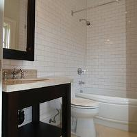 Designer Friend - bathrooms - ebony, stained, single, bathroom vanity, ebony, stained, framed, mirror, travertine, countertop, subway tiles, backsplash, shower surround, polished nickel, faucet, subway tile shower, white subway tile, subway tile bathroom, white subway tile bathroom, white subway tile shower,